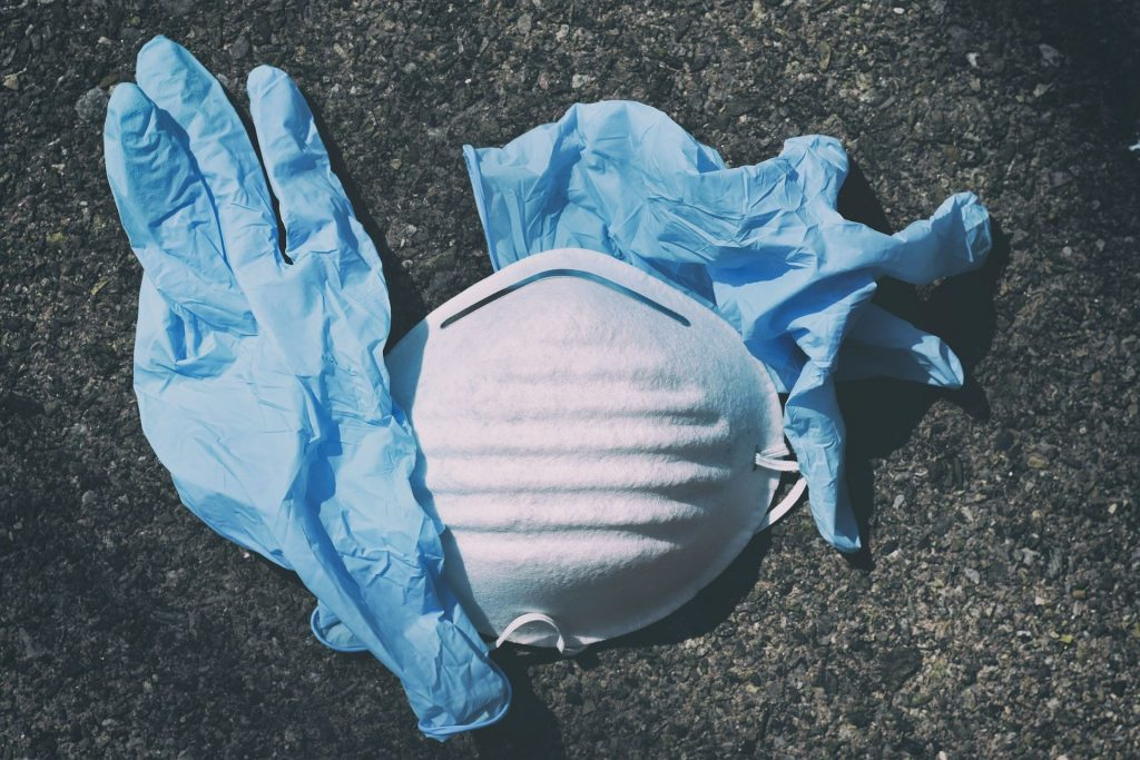 disposable mask and gloves on the floor